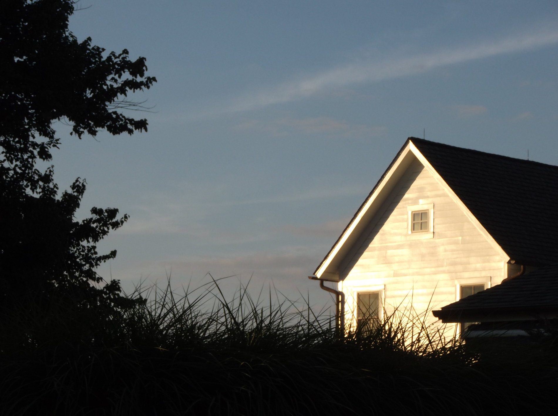 House with sun and sky